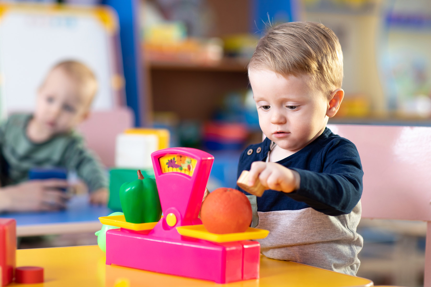 Rocking Horse Creche and Preschool | Cute little kid boy playing with abacus in nursery | Youghal, Cork